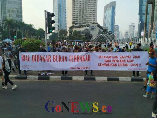 Aksi Protes di Bundaran HI, Warga Riau: Selamatkan Hutan Kami, Jangan Biarkan Kami Mati